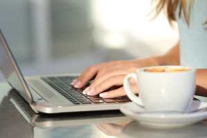 Woman Hands Typing In A Laptop In A Coffee Shop